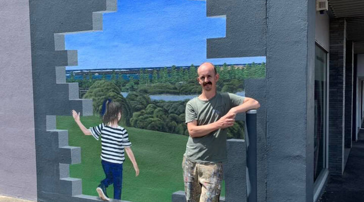 Jimmi Buscombe Standing in Front of New MacKillop Mural in Warrnambool